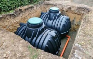 below ground rainwater tank being installed in Ipswich